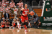 February 25, 2016: Asia Durr #25 of Louisville in action during the NCAA basketball game between the Miami Hurricanes and the Louisville Cardinals in Coral Gables, Florida. The Cardinals defeated the 'Canes 79-51.