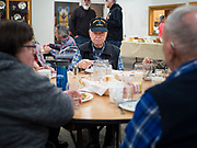 """26 FEBRUARY 2020 - FARMINGTON, MINNESOTA: GARY HOLSTAD eats dinner at the community dinner at Faith Church, a United Methodist Church in Farmington, MN, about 30 minutes south of the Twin Cities. The dinner is sponsored by Loaves & Fishes, a Christian organization that provides food for community dinners and foodbanks. Farmington, with a population of 21,000, is a farming community that has become a Twin Cities suburb. The city lost its only grocery store, a Family Fresh Market, in December, 2019. The closing turned the town into a """"food desert."""" In January, Faith Church started serving the weekly meals as a response to the store's closing. About 125 people per week attend the meal at the church, which is just a few blocks from the closed grocery store. The USDA defines food deserts as having at least 33% or 500 people of a census tract's population in an urban area living 1 mile from a large grocery store or supermarket. Grocery chains Hy-Vee and Aldi both own land in Farmington but they have not said when they plan to build or open stores in the town.      PHOTO BY JACK KURTZ"""
