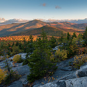 Views of distant mountain peaks during peak foliage from Black Cap Summit in Intervale, NH