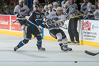 KELOWNA, CANADA - APRIL 17: Tyler Soy #17 of Victoria Royals checks Rourke Chartier #14 of Kelowna Rockets as he passes the puck during third period on April 17, 2016 at Prospera Place in Kelowna, British Columbia, Canada.  (Photo by Marissa Baecker/Shoot the Breeze)  *** Local Caption ***Tyler Soy; Rourke Chartier;