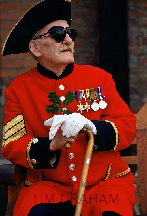 Chelsea Pensioner in red coat and tricorn hat on Founder's Day Parade at Royal Hospital, Chelsea, London, UK.