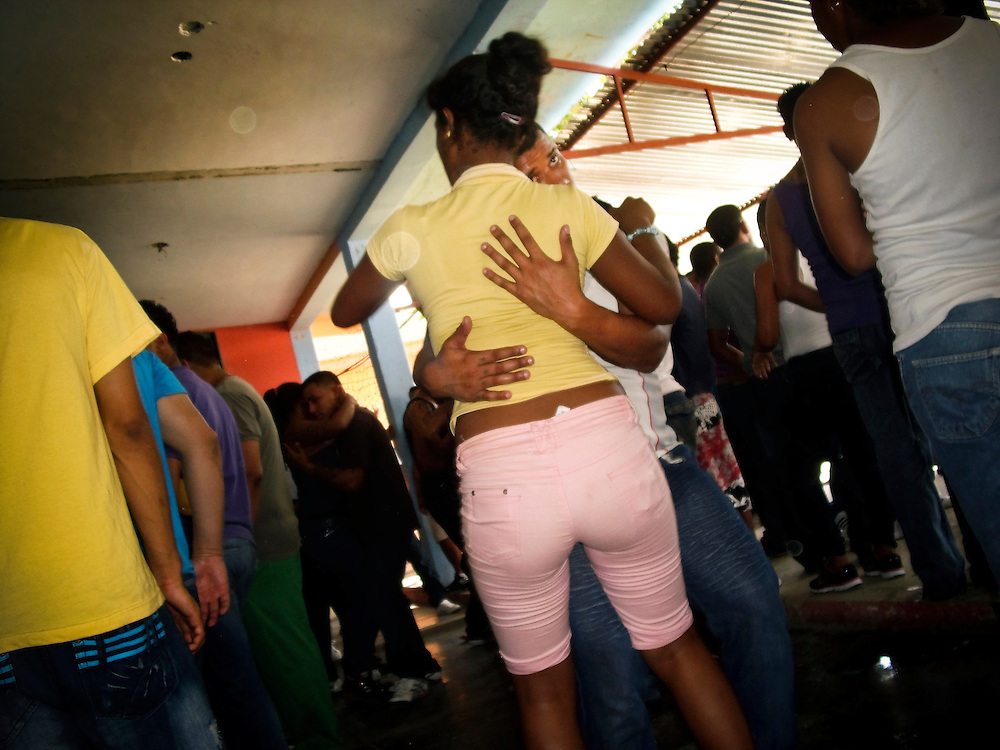 """Prisoners party and dance to reggaeton music at a discothèque inside San Antonio prison in Venezuela. The prison in Porlamar on Margarita Island houses 2,000 inmates, and is known amongst criminals as the prime place to serve time.  It is unofficially run by convicted drug trafficker, Teófilo Rodríguez, who said in an interview that his goal was to create an atmosphere inside the prison as a, """"peaceful party"""".  During his reign at the prison, Rodríguez has constructed four swimming pools, a cockfighting arena, hosts hip hop concerts and dances at the prison discothèque, and has built over 200 private rooms where prisoners may enjoy conjugal visits three times a week."""