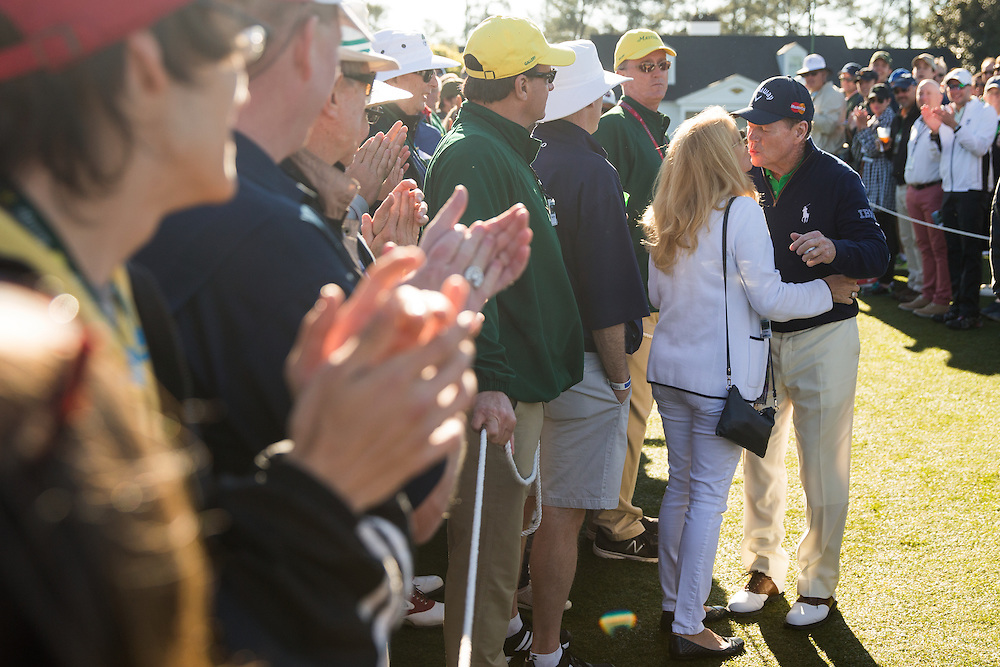 1977 and 1981 Masters champion Tom Watson kisses his wife, Hilary, on his way to the first tee before the first round of the 2016 Masters Tournament. Golf: 2016 Masters<br /> Round 1 Thursday<br /> Augusta National/Augusta, GA, <br /> 04/07/2016<br /> SI-14 TK1<br /> Credit: Darren Carroll