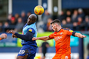 Wycombe Wanderers forward Adebayo Akinfenwa and Luton Town defender Matthew Person in the air challenge for the ball during the EFL Sky Bet League 1 match between Luton Town and Wycombe Wanderers at Kenilworth Road, Luton, England on 9 February 2019.
