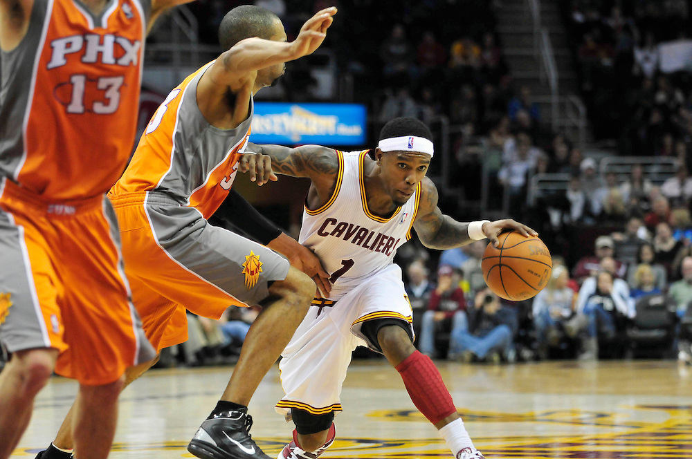Jan. 19, 2011; Cleveland, OH, USA; Cleveland Cavaliers point guard Daniel Gibson (1) tries to drive around Phoenix Suns small forward Grant Hill (33) during the third quarter at Quicken Loans Arena. The Suns beat the Cavaliers 106-98. Mandatory Credit: Jason Miller-US PRESSWIRE