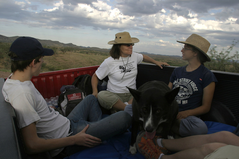 Volunteers with the No More Deaths humanitarian organization patrol the Arizona desert looking for undocumented immigrants in need of help near the town of Arvaka on 13 July 2006.