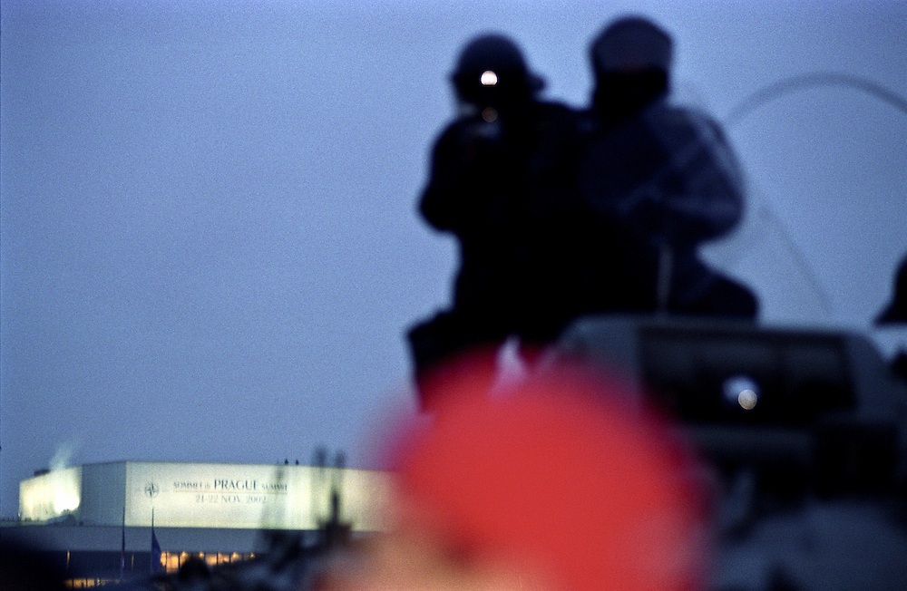 Police forces protecting the Prague congress center during the Nato summit 2002.