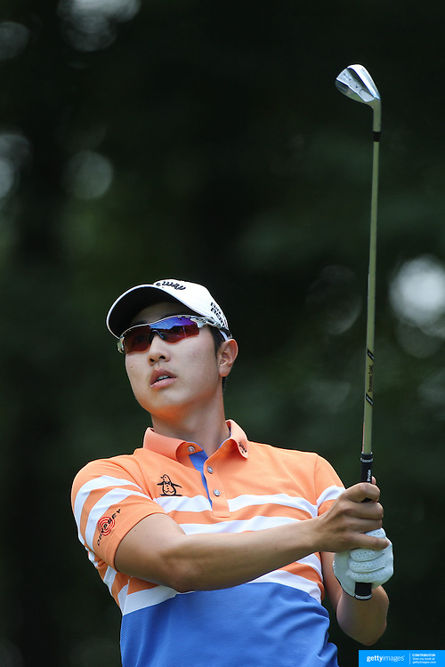 Sang-Moon Bae, South Korea, in action during the third round of the Travelers Championship at the TPC River Highlands, Cromwell, Connecticut, USA. 21st June 2014. Photo Tim Clayton