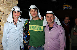 Left to right, DOM ROBERTSON, HUGH VAN CUTSEM and IAN ROBERTSON at a fundraising party ay Umbaba nightclub, London on 5th April 2005 for Hugh Van Cutsem and brothers DOM and IAN ROBERTSON who intend to compete in the Marathon de Sables - 140 mile journey across the Sahara Desert in 7 days.  Money raised will go to their chosen charities the Fara Foundation and the Ian Maclay Leukaemia Trust.<br />