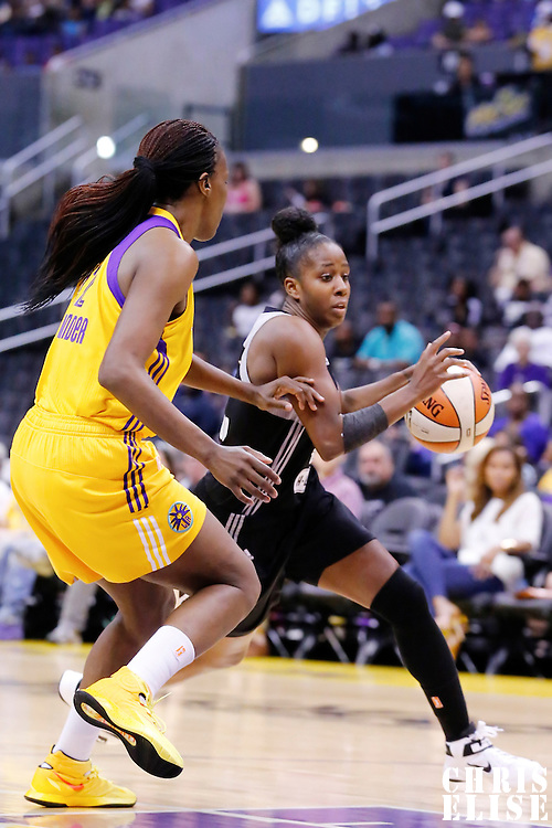 25 May 2014: San Antonio Stars guard Shenise Johnson (42) drives past Los Angeles Sparks center Jantel Lavender (42) during the Los Angeles Sparks 83-62 victory over the San Antonio Stars, at the Staples Center, Los Angeles, California, USA.