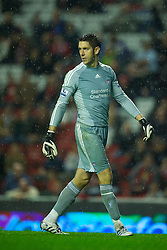 LIVERPOOL, ENGLAND - Wednesday, September 22, 2010: Liverpool's goalkeeper Brad Jones looks dejected after conceding a second Northampton Town goal during Extra Time in his debut, the Football League Cup 3rd Round match at Anfield. (Photo by David Rawcliffe/Propaganda)