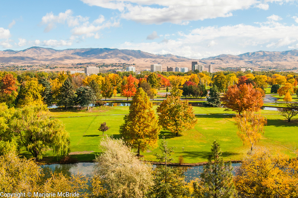 Colorful autumn skyline of downtown Boise, Idaho with the foothills beyond.