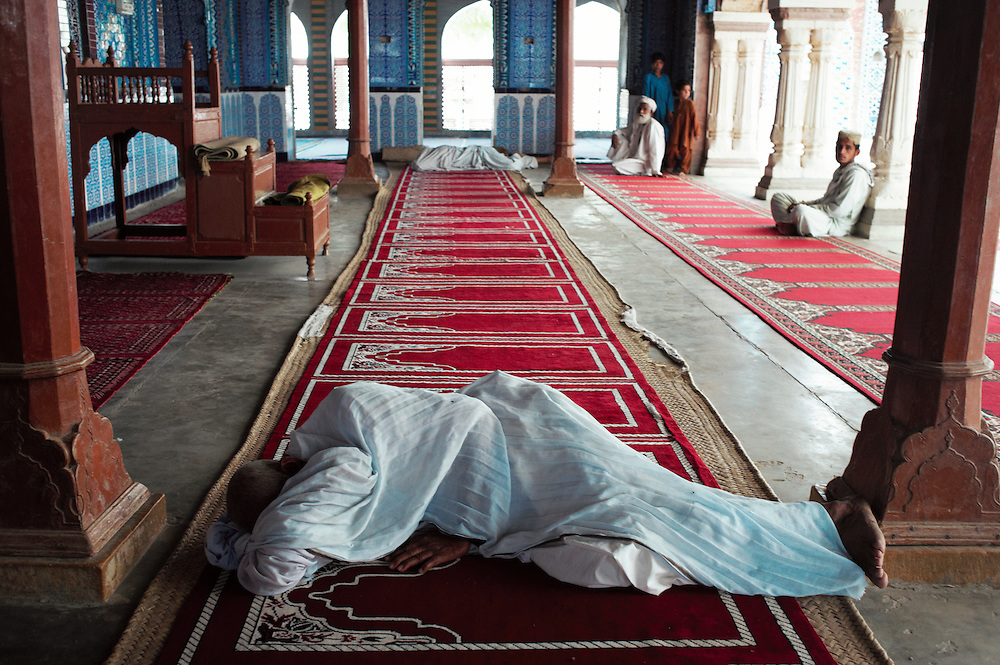 A man sleeps before prayer times at Bharchundi Sharif, a Muslim shrine in Ghotki district, Sindh, Pakistan on March 23, 2012.A rise in in reports of forced conversion of Hindu girls to Islam in provinces in Pakistan has gained prominence within the political, media, religious and social domains with the case of a 21 year old woman Rinkle Kumari. On February 24, 2012 her family reported to police of Ghotki district, Sindh province that she had been abducted by armed men from the family home in the village of Mirpur Mathelo. it is then alleged by the family and broadrer hindu community that she was forced to convert to Islam and marry Syed Naveed Shah, a neighbour of the girl within their village. Complications with court hearings for the case, perceptions by the Muslim community that the police sided with the Muslim community when dealing with issue and the politicisation of the case by a Pakistan Peoples Party Member for National Assembly Mian Abdul Haq alias Mian Mitho has led to a hearing being called in the Supreme Court, Islamabad, Pakistan on March 26, 2012. The hearing will hopefully ascertain whether the girl was abducted or in fact left with Syed Naveed Shah of her own free will.