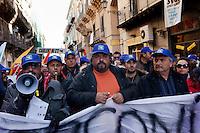"""Palermo, Sicily, Italy - 25 January, 2012: Thousands of people protest during the demonstration organized by the Movimento dei Forconi (Pitchfork Movement), a movement of farmers, shepherds, breeders and fishermen united against the increasing prices of fuel, against corruption, political deafness, Prime Minister Monti and ECB politics. The Pitchforks Movement self-declares itself as """"non-political"""" and """"against party politcs"""", while many observers have denounced the presence of far-right and neo-fascists organizations and parties within or in support of it. Calls for more indipendence from the central government go along with hopes to spread the revolt to the whole Country.  ### Palermo, Sicilia, Italia - 25 gennaio 2012: Migliaia di persone partecipano alla manifestazione organizzata dal Movimento dei Forconi, composto da agricoltori, pastori, allevatori e pescatori uniti contro  l'aumento della benzina, contro la corruzione, contro una politica assente, il Primo Ministro Mario Monti e le politiche della BCE. Il Movimento si dichiara apartitico e apolitico, benché gli osservatori hanno denunciato la presenza di movimenti di estrema destra come Forza Nuova. Il Movimento dei Forconi chiede inoltre una maggiore indipendenza della Sicilia e spera di diffondere la rivolta in tutto il paese."""