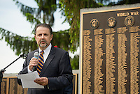 "Mayor Ed Engler speaks to the crowd of ""remembrance"" during the Memorial Day service at Veteran's Square on Monday morning.  (Karen Bobotas/for the Laconia Daily Sun)"