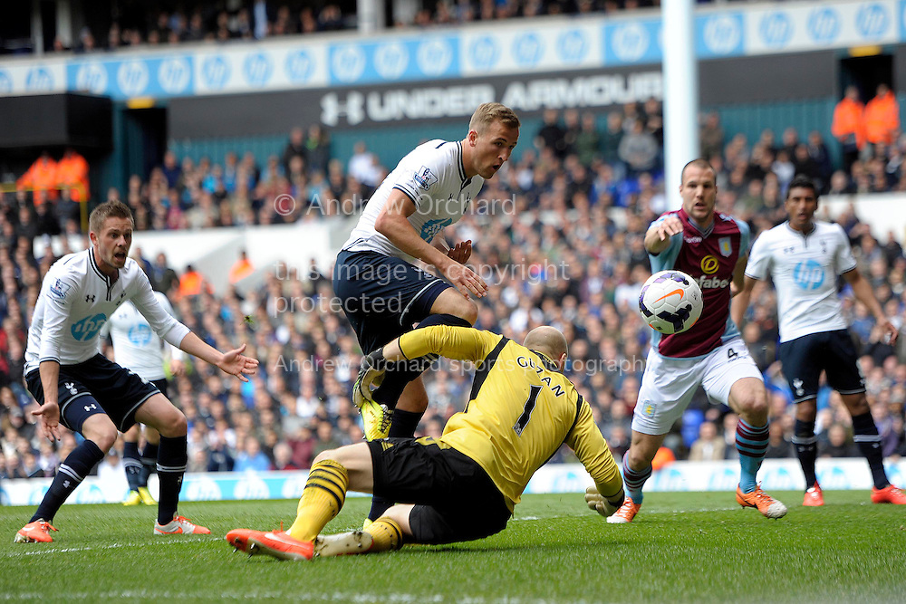 Tottenham Hotspur's Harry Kane chips the ball over Aston Villa goalkeeper Brad Guzan but doesn't score. Barclays premier league match ,Tottenham Hotspur v Aston Villa at White Hart Lane in Tottenham, London  on Sunday 11th May 2014.<br /> pic by John Patrick Fletcher, Andrew Orchard sports photography.