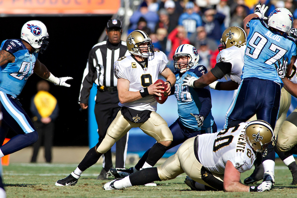 NASHVILLE, TN - DECEMBER 11:   Drew Brees #9 of the New Orleans Saints tries to avoid the rush from the defense of the Tennessee Titans at LP Field on December 11, 2011 in Nashville, Tennessee.  The Saints defeated the Titans 22-17.  (Photo by Wesley Hitt/Getty Images) *** Local Caption *** Drew Brees