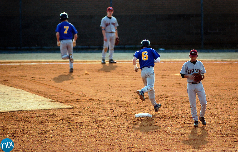 Mount Pleasant's Brandon Burris (6) and Andrew Carroll (7) round the bases after Burris hit a two-run homerun in the second inning against Gray Stone Day School Friday afternoon in Mount Pleasant.