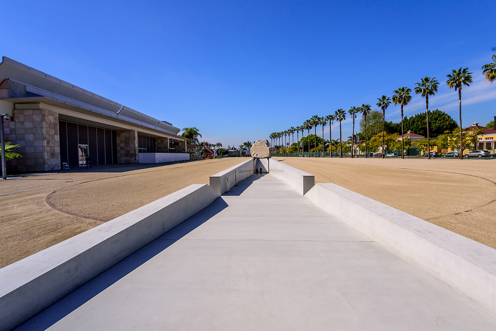 Los Angeles County Museum of Art, LACMA, Los Angeles, California, Levitated Mass by artist Michael Heizer is composed of a 456-foot-long slot constructed on LACMA's campus, over which is placed a 340-ton granite megalith