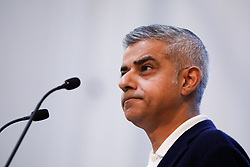 © Licensed to London News Pictures. 13/01/2018. London, UK. Mayor of London SADIQ KHAN speaks while he is heckled by a group of protesters shouting pro-Brexit and Pro-Donald Trump slogans, at the Fabian Society New Year conference in London. Police were called to deal with the incident at the annual gathering of the British socialist movement.  Photo credit: Tom Nicholson/LNP