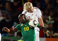 Fotball<br /> VM 2010<br /> Danmark v Kamerun<br /> 19.06.2010<br /> Foto: Gepa/Digitalsport<br /> NORWAY ONLY<br /> <br /> Bild zeigt Achille Emana (DEN) und Simon Kjær (DEN).