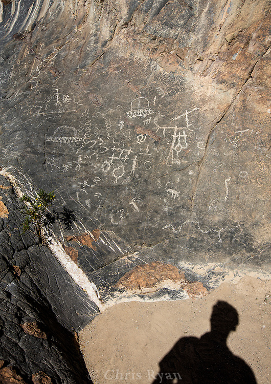 Self-portrait with petroglyphs, Death Valley, California