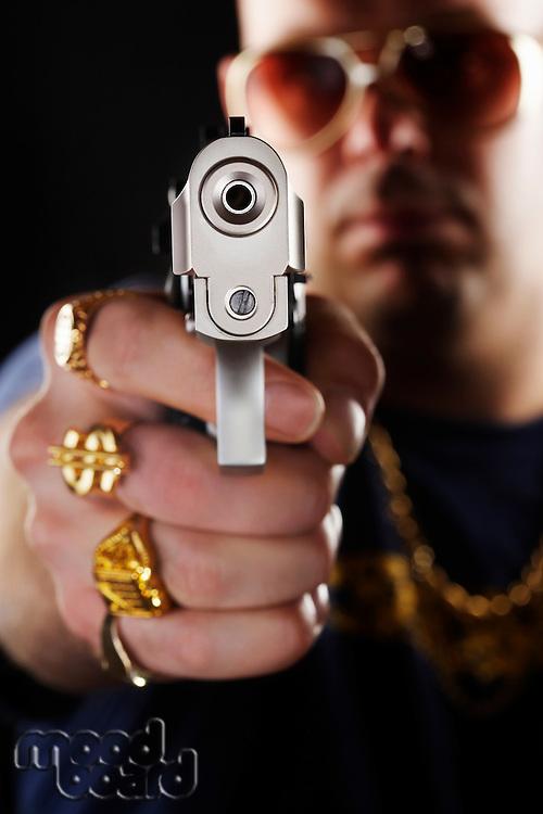 Man holding gun focus on hand