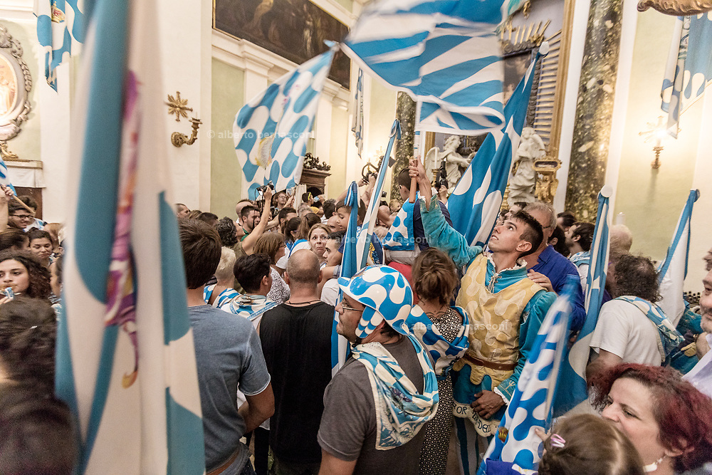 Italy, Siena, the Palio: the arrival of the Palio and the Jockey at the local church of San Giuseppe of the contrada dell'Onda.