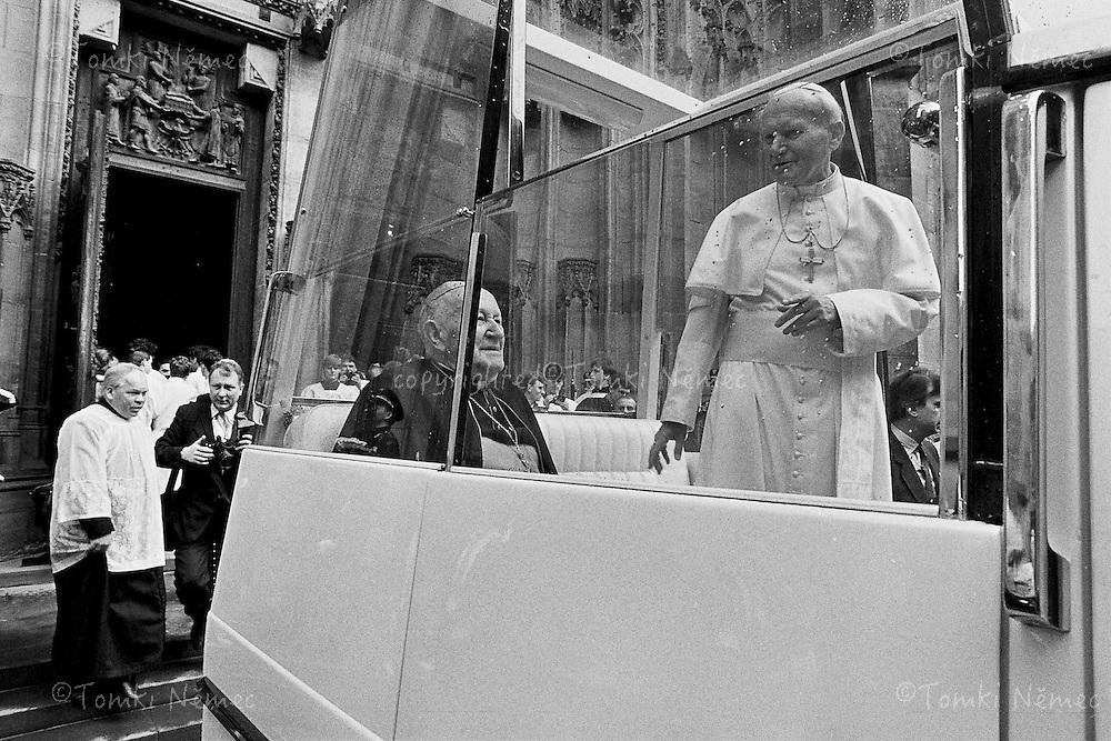 Pope John Paul II is walking in the cathedral of Svaty Vit in Prague a few weeks after the Velvet revolution in Czechoslovakia.