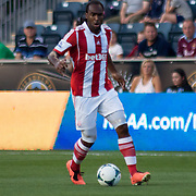 Stoke City F.C. Striker CAMERON JEROME (33) dribbles the ball in front of him in the first half a MLS regular season international friendly match against the Philadelphia Union Tuesday, July. 30, 2013 at PPL Park in Chester PA.