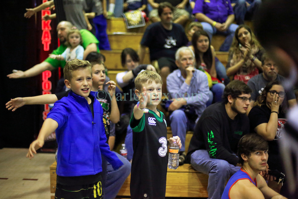 12 March 2016. Metairie, Louisiana.<br /> Wrestling action from Wildkat Sports and Entertainment's 'March into Mayhem' at the Meisler Middle School. Kids Ben and Brody take in the action.<br /> Photo&copy;; Charlie Varley/varleypix.com