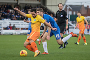 Sam Wood (Midfielder) of Wycombe Wanderers on ther ball shadowed by Hartlepool United striker Rhys Oates the Sky Bet League 2 match between Hartlepool United and Wycombe Wanderers at Victoria Park, Hartlepool, England on 16 January 2016. Photo by George Ledger.