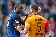 Uche Ikpeazu (#19) of Heart of Midlothian and Tom Aldred (#5) of Motherwell FC during the Ladbrokes Scottish Premiership match between Motherwell and Heart of Midlothian at Fir Park, Motherwell, Scotland on 15 September 2018.
