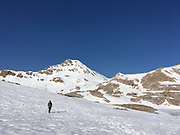 Ben Blain walks along a snow field deep in California's Sierra Nevada on June 7, 2018. Despite 2018 being considered a low snow year in the Sierra, miles of snowfields on either side of Muir Pass made for long hours navigating the white landscape with no marked trail to follow other than the footsteps of earlier hikers.