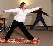 Sandy Wright (left) leads a yoga class at The Studio, in Beavercreek, Thursday, March 22nd.  Dawn Stevens, from Dayton is on the right.