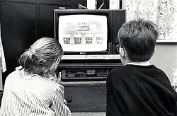 Two children watching tv, UK 1991
