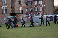Riot police surrounding St Agnes Place squat in South London during final eviction November 2005.