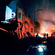 Collapsed buildings burn in the Marina District of San Francisco, California after the 6.9 magnitude 1989 Loma Prieta earthquake.