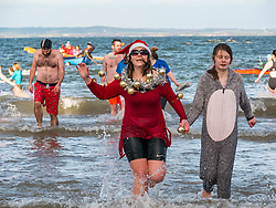 Pictured: Loony Dook. People brave the cold water of West Bay in the Firth of Forth on New Year's Day, in a modern tradition known as the Loony Dook. The first event in 1986 was a joke suggestion for a New Year's Day hangover cure by three locals in South Queensferry which has since grown into a fee paying organised event to raise money for charities, and now repeated in coastal towns around the Firth of Forth. Sally Anderson / Edinburgh Elite media
