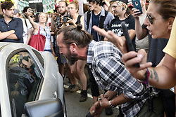 Protestors lock arms as a government vehicle, driven by Unites States Secret Service agents attempt to drive trough the crowd during a protest as Vice President Mike Pence is visiting an event organized by Republican Governors Association (RGA) at a Rittehouse Square hotel, in Philadelphia, PA, on June 19, 2018.
