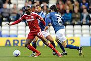 Middlesbrough midfielder Albert Adomah turns Birmingham City midfielder David Davis  ands Birmingham City striker Diego Fabbrini  during the Sky Bet Championship match between Birmingham City and Middlesbrough at St Andrews, Birmingham, England on 29 April 2016. Photo by Alan Franklin.
