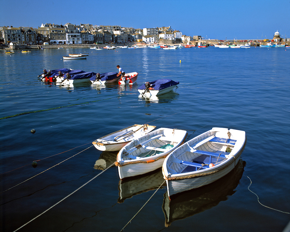 Small boats stand at the ready at the harbor, St. Ives, Cornwall, England.
