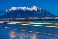 View toward Cape Town (with Table Mountain in background) from the beach at Milnerton, South Africa.