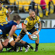 TJ Perenara passes the ball during the super rugby union  game between Hurricanes  and Highlanders, played at Westpac Stadium, Wellington, New Zealand on 24 March 2018.  Hurricanes won 29-12.