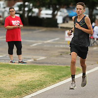 Payton Temple, 18, of Saltillo wins this year's Green Street Mile Wednesdya morning in Tupelo.