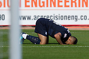 6th October 2018, Dens Park, Dundee, Scotland; Ladbrokes Premiership football, Dundee versus Kilmarnock; Adil Nabi of Dundee kisses the pitch after scoring for 1-0 in the 10th minute