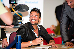 "Peter Andre Signs copies of his new childrens books ""The Happy Birthday Party"" and ""A New Day at School"" in WH Smiths Sheffield while being filmed for his TV show .6th September2011 Image © Paul David Drabble"