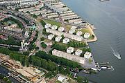 Nederland, Amsterdam-Noord, IJplein, 17-06-2008; in de voorgrond de Sixhaven (bouwplaats en bouwput NZ-lijn); links - onder het midden - ventilatietorens IJ-tunnel; midden rechts het IJplein (ontwerp Rem Koolhaas), tweede plan (boven) nieuwbouwflats op voormalig industrieterein (ADM / scheepsbouw), aan het water restaurant Wilhelminadok (oranje gebouwtje); Vogelbuurt..luchtfoto (toeslag); aerial photo (additional fee required); .foto Siebe Swart / photo Siebe Swart