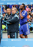 Football - 2014 / 2015 Premier League - Chelsea vs. Sunderland.   <br /> <br /> Chelsea's Mikel John Obi without a medal stands away and alone from the other players while they celebrate their title win at Stamford Bridge. <br /> <br /> <br /> COLORSPORT/DANIEL BEARHAM