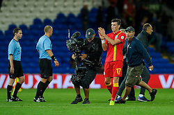 Gareth Bale of Wales (Real Madrid) is followed by a TV camera crew as he applauds the spectators afer the match - Photo mandatory by-line: Rogan Thomson/JMP - Tel: Mobile: 07966 386802 10/09/2013 - SPORT - FOOTBALL - Cardiff City Stadium - Cardiff -  Wales V Serbia- World Cup Qualifier.